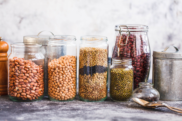 plant-based pantry staples: jars of beans and lentils