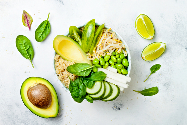buddha bowl with nutritious avocado, basil, quinoa, cucumber, lime