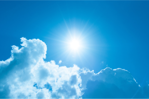 Sunshine and clouds with a blue sky - vitamin d source