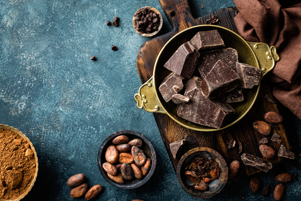 Dark chocolate pieces crushed and cocoa beans.