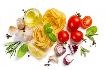 healthy diet of pasta, herbs and vegetables on white background.