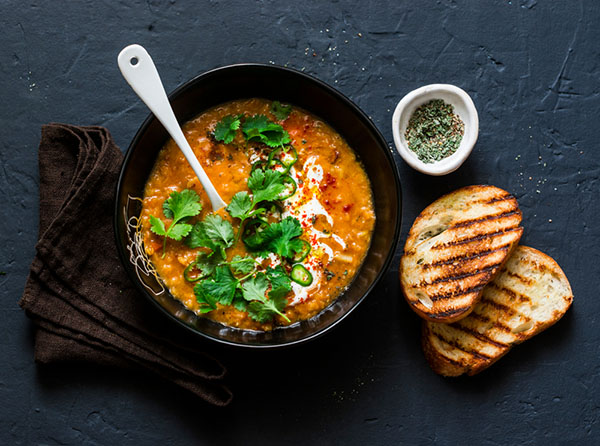 Lentil soup topped with vegetables