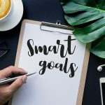 Smart goals text with hand writing on notepaper