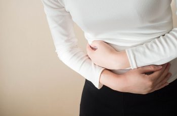 Young female suffering form IBS